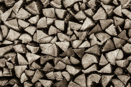 Texture of pile of chopped wood for the fireplace