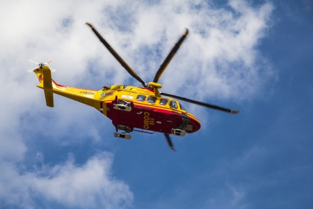 quickness: Rescue helicopter in flight Editorial