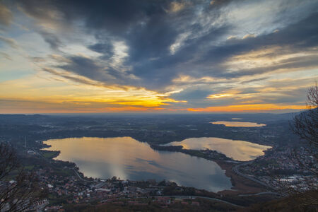 padania: From the top of Mount Barro  Lombardy  in the clear winter evenings you can admire spectacular sunsets reflected on the lakes of the plains Stock Photo