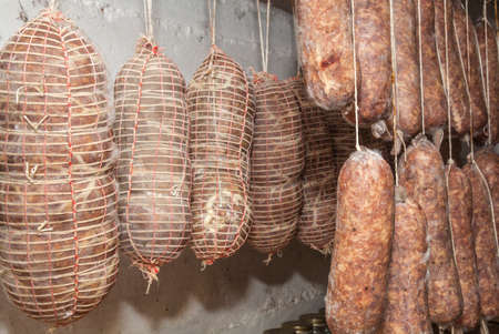 butcher s shop: Salami Italian handmade hanging to mature in the cellar