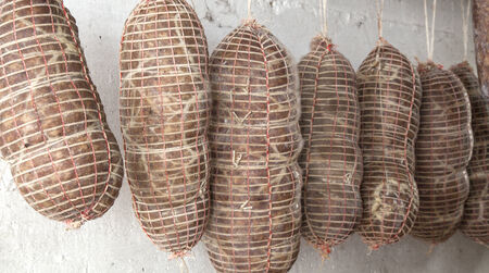 butcher's shop: Salami Italian handmade hanging to mature in the cellar