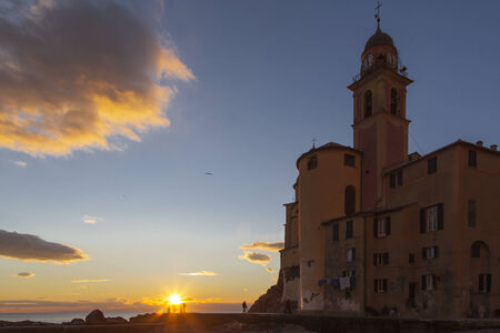 beach and church in Camogli, famous small town in Mediterranean sea, Italy near Genova photo