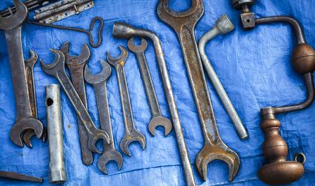 Set of old work tools on blu background photo