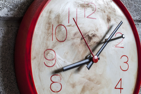 stop time: Clock with hands locked by a nail as a symbol of wanting to stop time Stock Photo