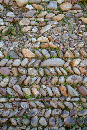 built: Italian old wall built with river stones