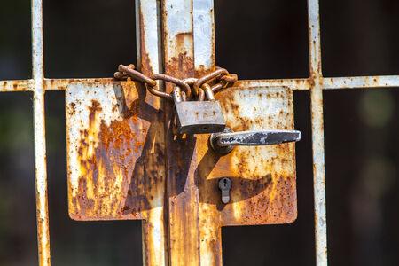 oxidize: Rusty chain with padlock iron Stock Photo
