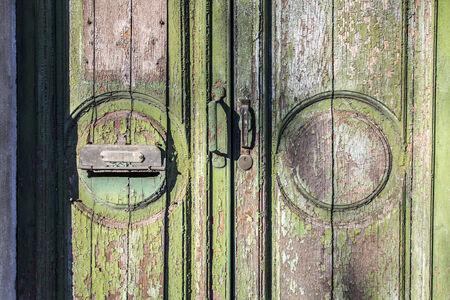 green door: Old green door peeling Stock Photo