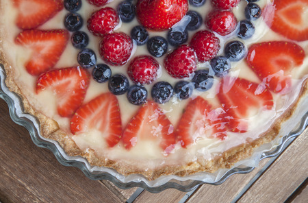 bove: Tart decorated with strawberries blueberries and raspberries Stock Photo