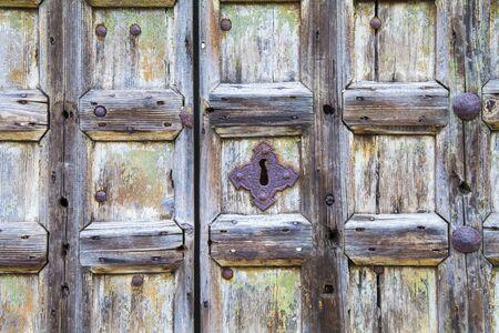old wooden door: Old wooden door with rusty handles