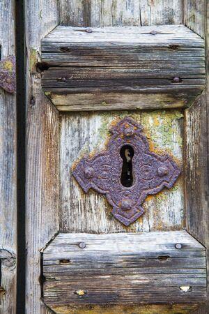 handles: Old wooden door with rusty handles