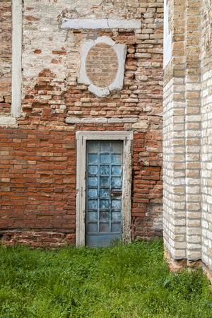 green door: Blue door on red brick wall Stock Photo