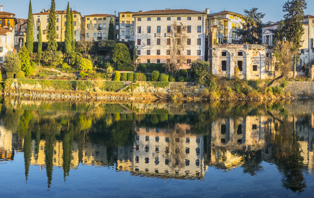 Reflections of the palaces on the banks of the Brenta in Bassano del Grappa