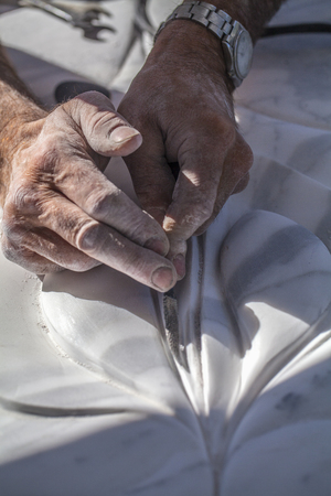 Hands of an artist who finishes his work
