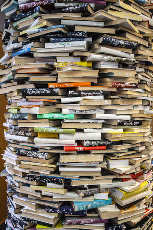 A large quantity of books stacked like a column Archivio Fotografico