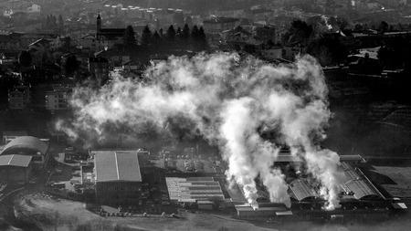 Smoke from industry in winter in black and white