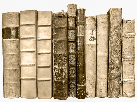 Old books lined isolated on white