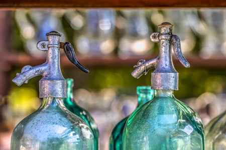 Old colored seltz bottles Archivio Fotografico