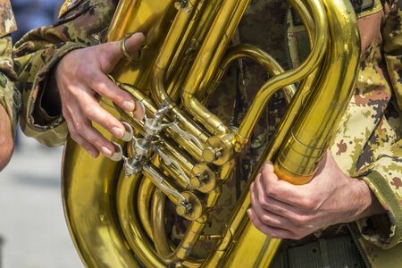 Hands playing the trombone