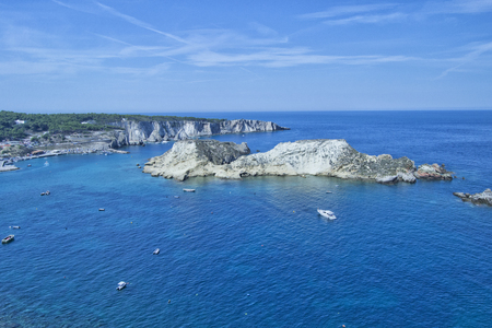 castel: Tremiti islands with blue water, boats and clouds