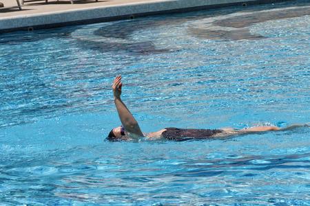 backstroke: Woman backstroke swimming in spa pool