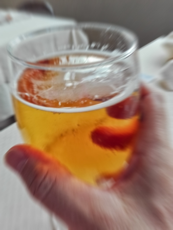 blur picture of a beer glass in mans  hand to simulate overdrink Stock Photo