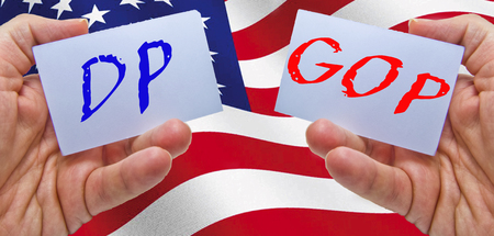 man hands keepend cards with DP and GOP, vote for political elections day with usa flag used as background Stock Photo