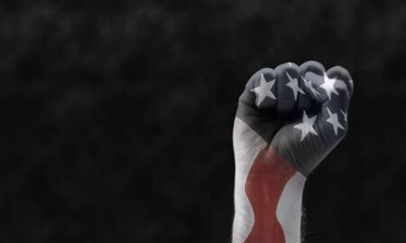 fist with american flag in transparency. concept for black lives matter protest agains racism and law enforcement violences
