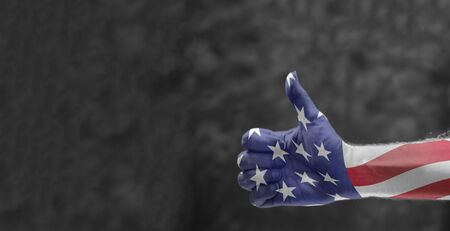 thumb up with usa flag.  patriotic, political, election, independence concept Imagens