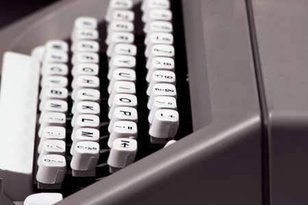 keyboard of an old manual typewriter: white keys and black letters Imagens