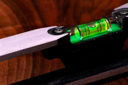 green spirit level bubble.concept for engineering and construction job