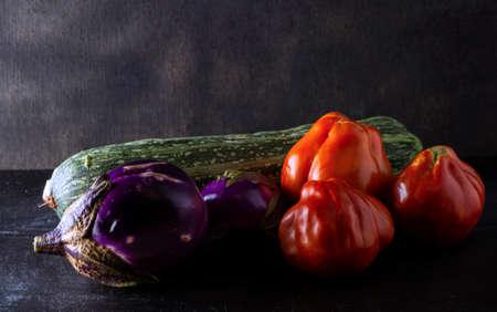 bio food vegetables on a black background. concept for natural lifestyle, healthy food, vegan philosophy, km0 food