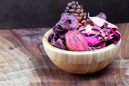 Decoration with candle light and dried flowers potpourri