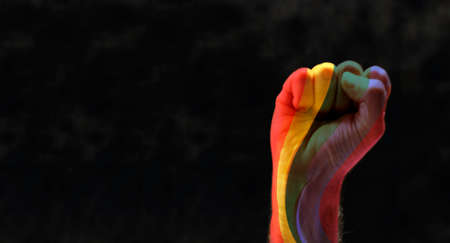 fist with rainbow. concept for lgbq protest agains discrimination Imagens