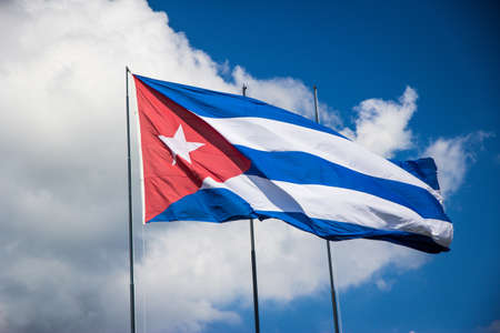 Cuba flag with sky and clouds