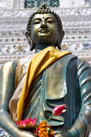 Buddha statue with lotus flower