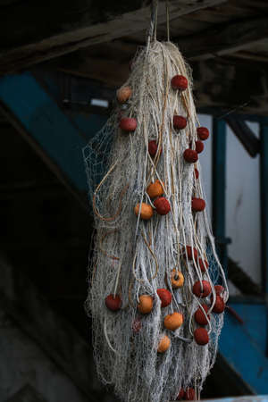 net trade: Fishnet hanging in daylight