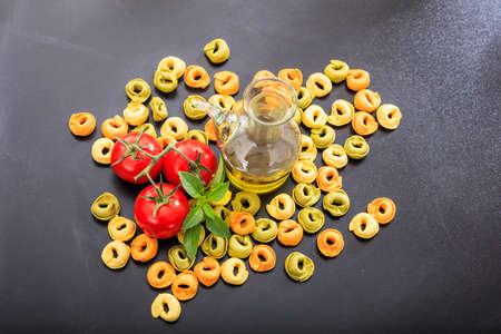 tortellini: Raw tortellini on black background