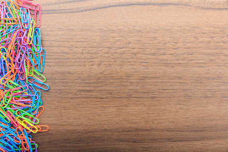 paperclips: Colorful paperclips on a wooden surface Stock Photo