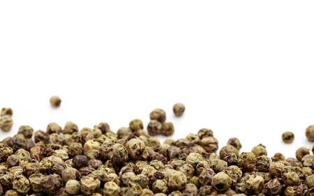 peppercorn: Green pepper seeds on white background