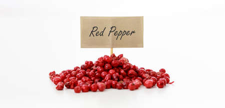 Red pepper seeds on white background
