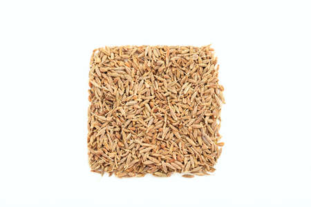 cumin: Cumin seeds on white background