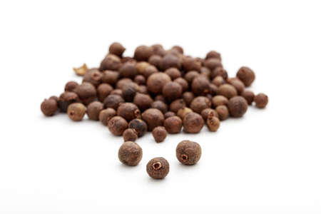 Allspice seeds on white background