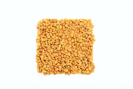 methi: Fenugreek seeds on white background
