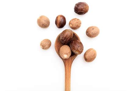 Nutmeg seeds on white background Stock Photo