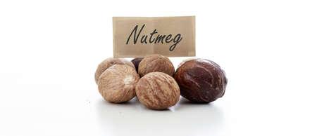 nutmeg: Nutmeg seeds on white background Stock Photo