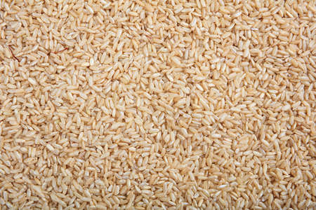 unrefined: Brown unrefined rice as background