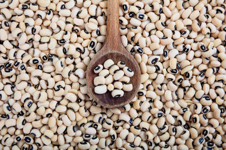 Wooden spoon and black eyed peas