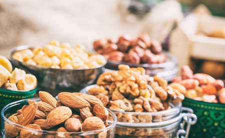 Almonds, peanuts and walnuts in bowls Stock Photo