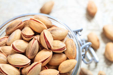 Pistachios in shell in a glass bowl
