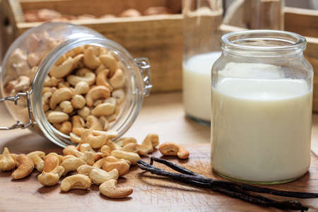 Vegan milk from cashews on a wooden surface